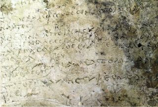 """The newfound clay slab may hold the first 13 verses of Homer's """"Odyssey."""""""