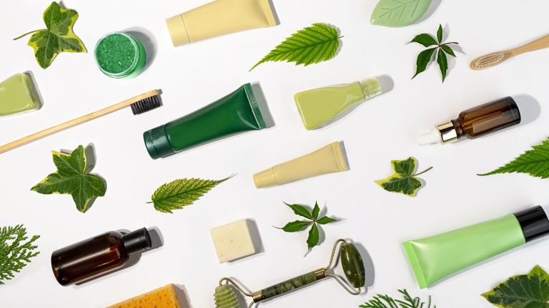natural skincare products and green leaves