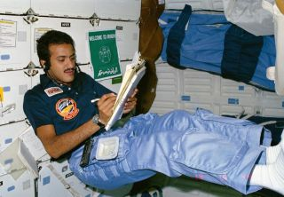 Saudi astronaut Sultan Salman Abdelize Al-Saud, a Saudi prince, logs notes while floating in the middeck of space shuttle discovery during the STS-51G mission to deploy the Arabsat-1B communications satellite in June 1985.