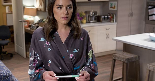 Paige takes a pregnancy test in Neighbours