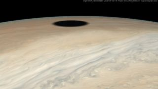 A glimpse of Io's shadow on the surface of Jupiter, taken by the Juno probe of NASA.