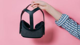 Woman holding Oculus Quest 2 headset
