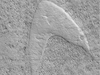 "NASA's Mars Reconnaissance Orbiter spotted a feature on Mars that looks like the famous ""Star Trek"" logo."