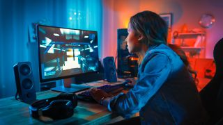 girl playing PC games