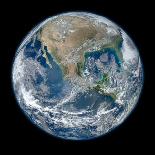 A 'Blue Marble' image of the Earth taken from the VIIRS instrument aboard NASA's most recently launched Earth-observing satellite - Suomi NPP. This composite image uses a number of swaths of the Earth's surface taken on Jan. 4, 2012.