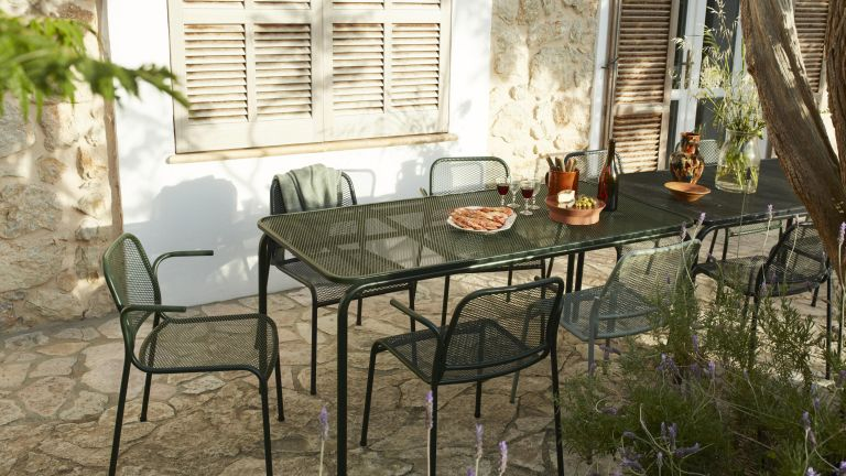Mediterranean gardens with a shady patio dining area