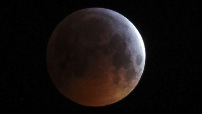 GRODNO REGION, BELARUS - JANUARY 21, 2019: A lunar eclipse over the village of Turets