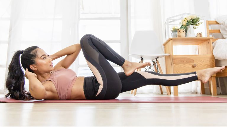 Woman doing a Pilates abs workout