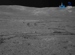 Tracks and the distant rim of Von Kármán crater, imaged by Yutu 2 in June 2020.