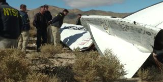 National Transportation Safety Board investigators survey debris from Virgin Galactic's SpaceShipTwo in California's Mojave Desert on Nov. 1, 2014, one day after the commercial space plane broke apart during a test flight from the Mojave Air and Space Por