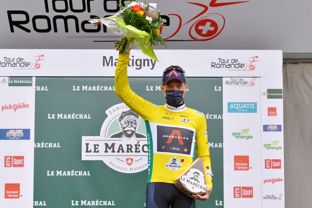 MARTIGNY SWITZERLAND APRIL 28 Rohan Dennis of Australia and Team INEOS Grenadiers Yellow Leader Jersey at podium during the 74th Tour De Romandie 2021 Stage 1 a 1681km stage from Aigle to Martigny Mask Covid safety measures Flowers Trophy TDR2021 TDRnonstop UCIworldtour on April 28 2021 in Martigny Switzerland Photo by Luc ClaessenGetty Images