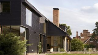 a large self build home with shou sugi ban charred timber cladding