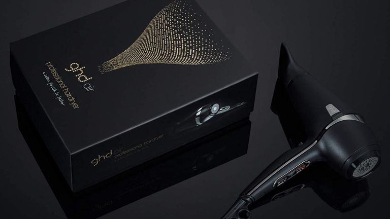 GHD Air hair dryer with box on black background