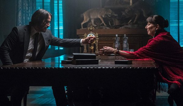 John Wick: Chapter 3 - Parabellum John offers his token to The Director in the study