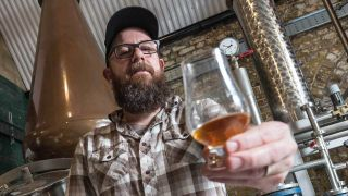 In Flames' Anders Fridén holds up a glass of whisky