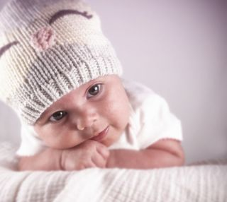 infant girl wearing winter hat.