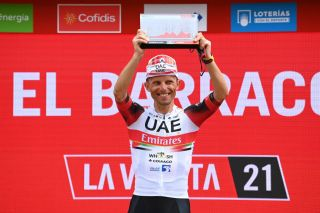 EL BARRACO SPAIN AUGUST 29 Rafal Majka of Poland and UAE Team Emirates celebrates winning the stage on the podium ceremony after the 76th Tour of Spain 2021 Stage 15 a 1975km km stage from Navalmoral de la Mata to El Barraco lavuelta LaVuelta21 on August 29 2021 in El Barraco Spain Photo by Stuart FranklinGetty Images
