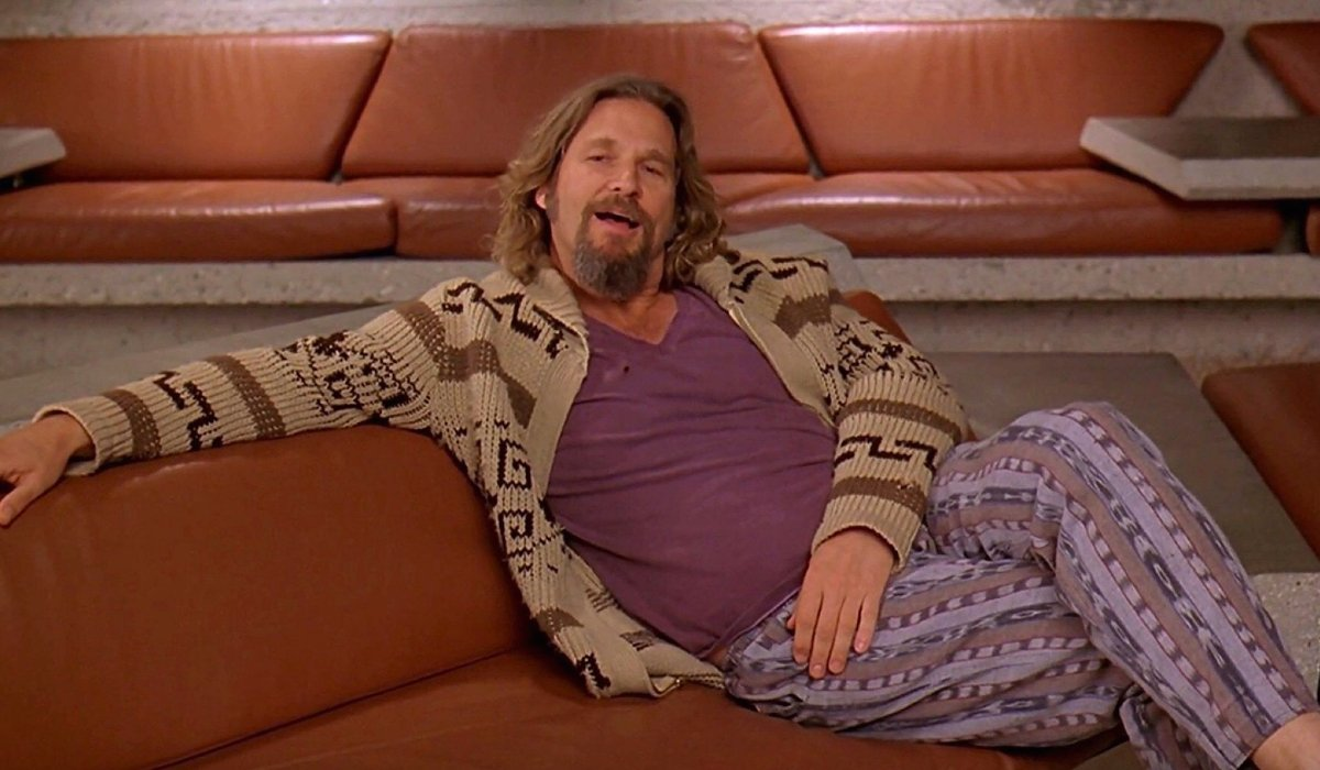 Jeff Bridges talks while relaxing on a couch in The Big Lebowski.