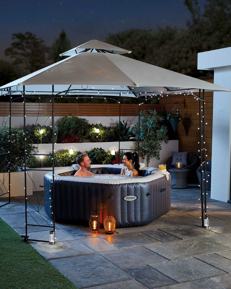 Aldi gazebo in garden with hot tub