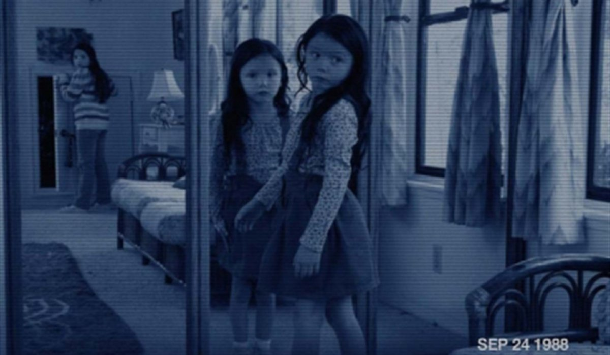 Paranormal Activity 3 a young girl's reflection stares at her