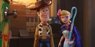 Toy Story 4 Woody and Bo Peep smiling together in the antique store