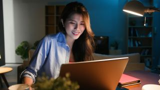 Woman using free video editing software on laptop