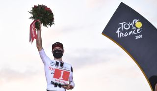 Team Sunweb rider Switzerlands Marc Hirschi celebrates his combativity prize at the end of the 21st and last stage of the 107th edition of the Tour de France cycling race 122 km between ManteslaJolie and Champs Elysees Paris on September 20 2020 Photo by AnneChristine POUJOULAT AFP Photo by ANNECHRISTINE POUJOULATAFP via Getty Images