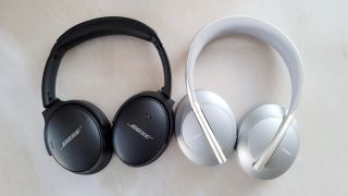 The Bose 700 headphones in black on the left next to the Bose QuietComfort 45 headphones in white