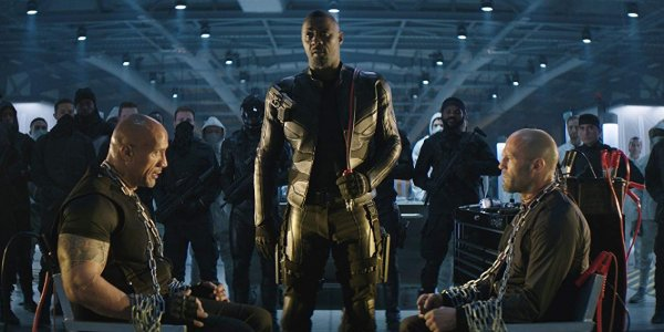 Hobbs & Shaw Brixton lording his jumper cable over a captive Hobbs & Shaw