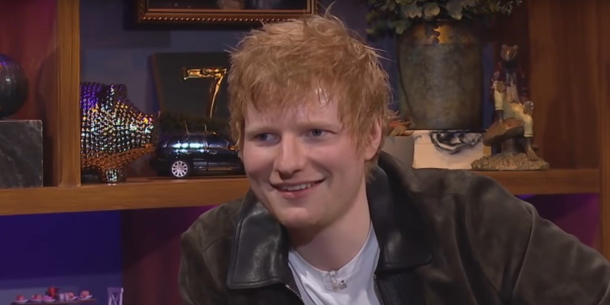 ed sheeran smiling while telling james corden a story on the late late show