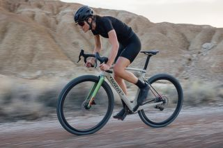 Cyclist rides the new Wilier Rave gravel bike over rocky terrain