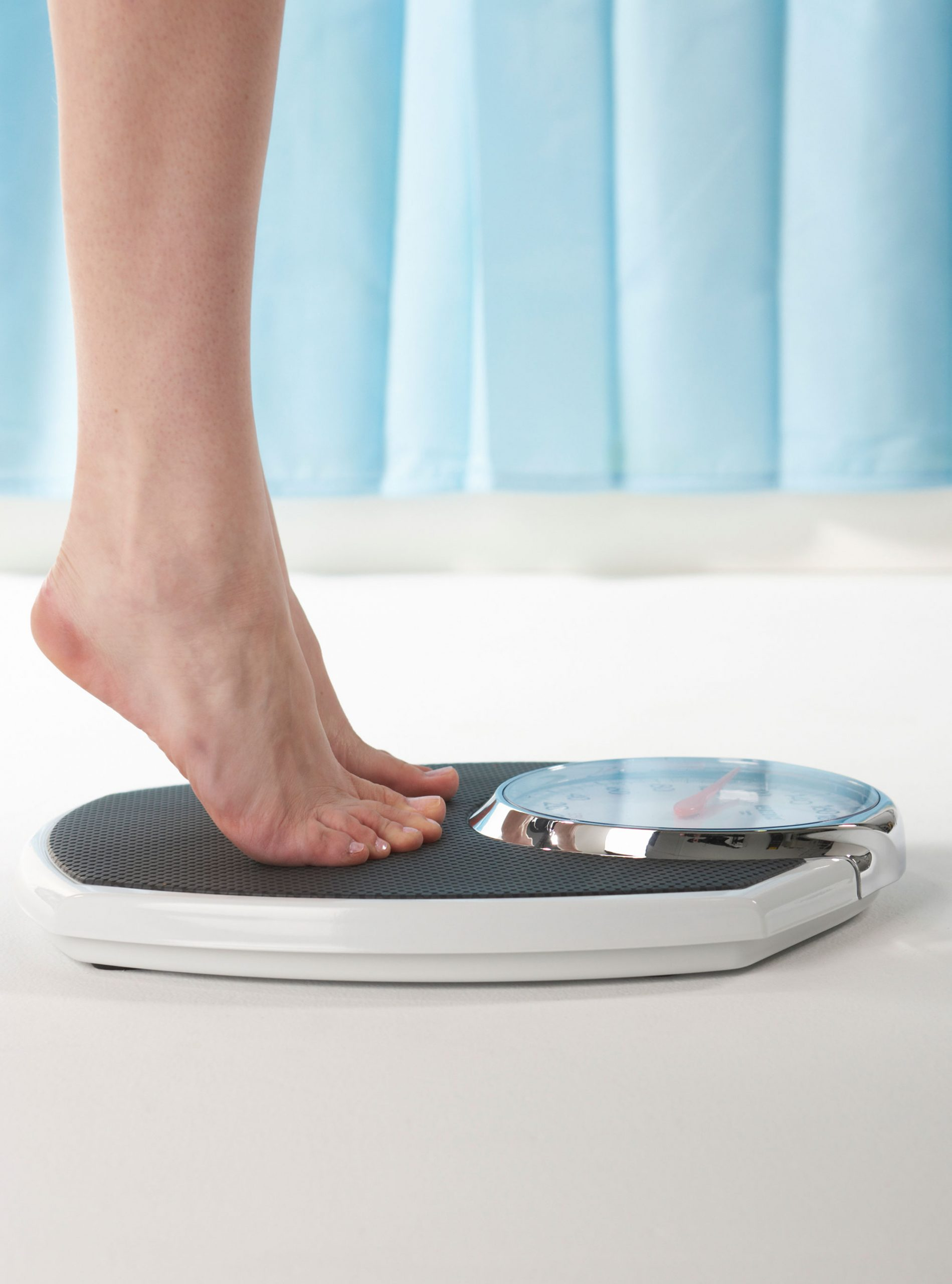 Woman on scales photo