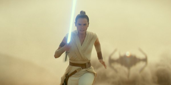 Rey running from a TIE fighter