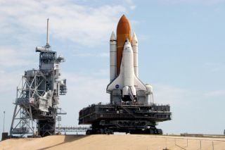 Space Shuttle Discovery Returns to Launch Pad