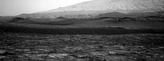 On Aug. 9, 2020, NASA's Curiosity Mars rover photographed a dust devil moving through Gale Crater, at the border between the darker and lighter slopes.