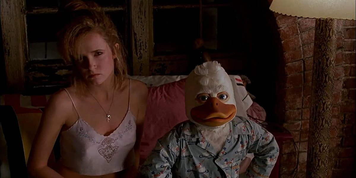 Howard The Duck Lea Thompson and Howard giving the camera dirty looks