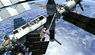 This still image from a NASA TV broadcast shows how Russian cosmonauts will move a crane outside the International Space Station during a spacewalk on Aug. 20, 2012.