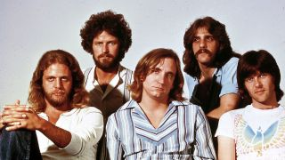 A posed, group photograph of the Eagles taken in the Hotel California era