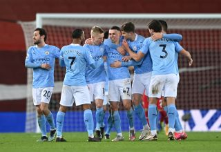 Phil Foden celebrates his goal with Manchester City teammates