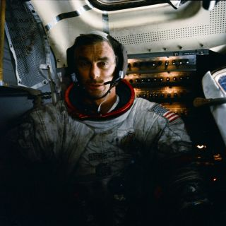 Eugene Cernan returned to the lunar module covered with moon dust.