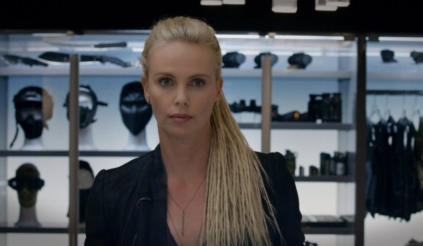 The Fate of the Furious Charlize Theron in front of an armor closet, with no emotion on her face