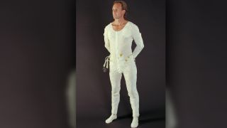 A man models an astronaut undergarment — known as a Liquid Cooling and Ventilation Garment — that was designed for the Space Shuttle/International Space Station Extravehicular Mobility Unit, photographed in 1994.