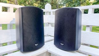 Klipsch AW-650 outdoor speakers positioned vertically on a deck