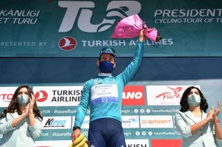 ALANYA TURKEY APRIL 13 Podium Mark Cavendish of United Kingdom and Team Deceuninck QuickStep Turquoise Leader Jersey Celebration during the 56th Presidential Cycling Tour of Turkey 2021 Stage 3 a 2126km stage from Beyehir to Alanya Mask Banana Trophy Covid Safety Measures TUR2021 tourofturkeyTUR on April 13 2021 in Alanya Turkey Photo by Stuart FranklinGetty Images