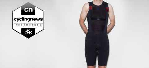 Reviewer wearing the Castelli Premio Black bib shorts, stood in front of a grey background, with 'recommends' badge overlaid