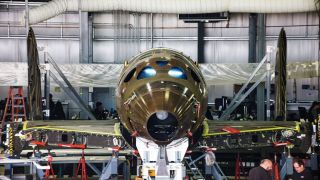 Virgin Galactic's manufacturing subsidiary, The Spaceship Company, has joined the fuselage and wing sections of the third SpaceShipTwo vehicles, company representatives announced on Sept. 16.