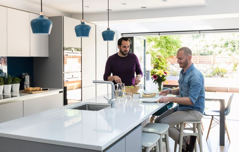 modern kitchen with white worktop in an open plan space with bifolds