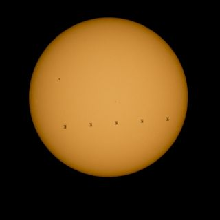 Space Station Crosses Sun's Face