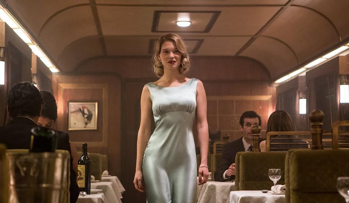 Spectre Madeleine walks through the dining car