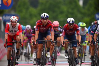 A frustrated Elia Viviani crosses the line on the right-hand side of the road at the Giro d'Italia